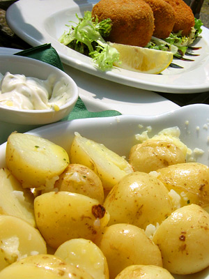 Potatoes and fishcakes at the Tiger Inn pub, East Dean village, East Sussex