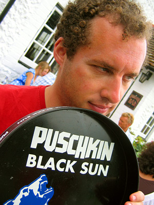 Adam with Puschkin drinks tray at the Tiger Inn, East Dean village, East Sussex