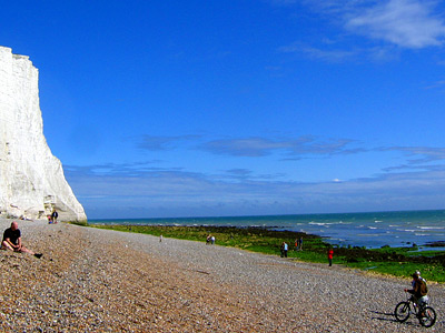White chalk cliffs and shingle beach at Cuckmere Haven, East Sussex