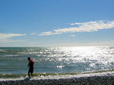 Wading in the sea at Cuckmere Haven, East Sussex