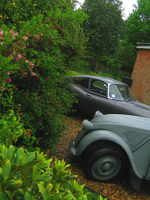 Old Citroen van and Jaguar E-type in driveway, Hebing End, Benington, Hertfordshire, England, Britain, UK