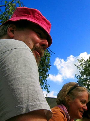 Ross wearing Anne's hat in the beer garden of the Curlew pub