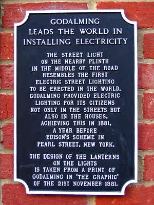 Plaque commemorating the first municipal installation of electricity, Godalming, Surrey, England